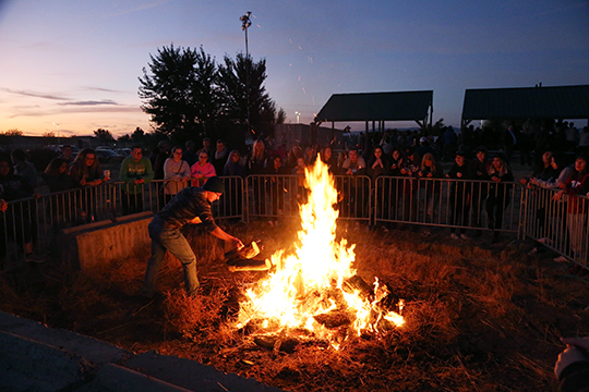 People gather around to make smores at Wellington's Wildfire during homecoming week last year.
