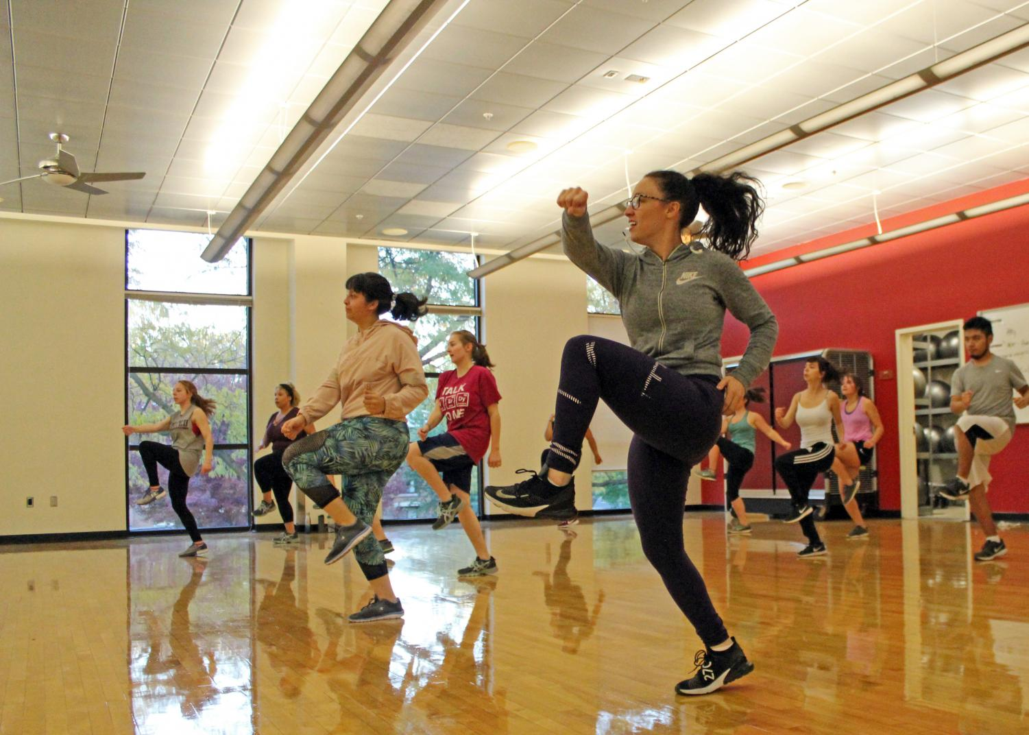 Jacqueline Flaherty shows her high-kick skills during a Zumba class at the CWU Recreation Center.
