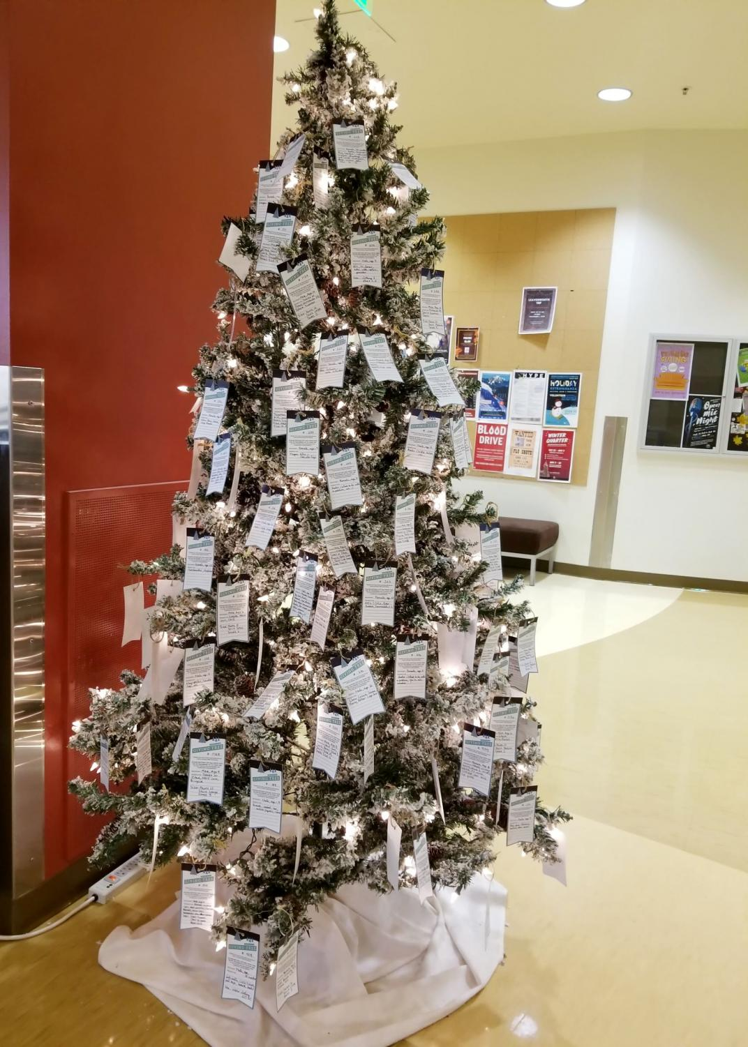 The Giving Tree is laden with cards detailing gift requests for boys and girls.