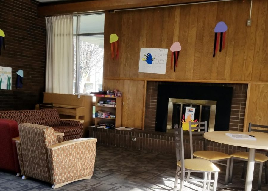 The fireplace in Moore Hall commons isn't needed just yet, now that the heaters have been fixed.