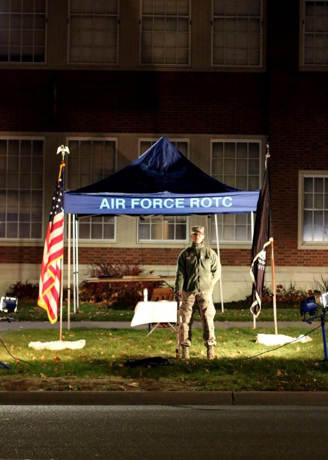 Air Force ROTC Eddie Marx holds his position in silence as as he honors those MIA and the POW during the 24-hour vigil on Sunday night. A candle burns as the cadets hold a position of honor for the veterans before them.