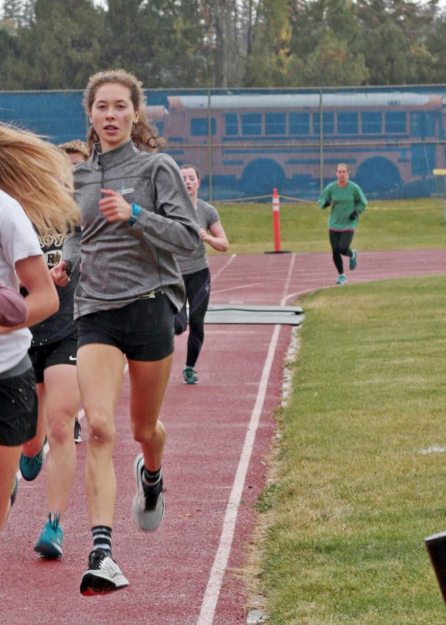 Nicole Soleim (Freshman) finds her best tempo at a rainy XC practice at Ellensburg High School.