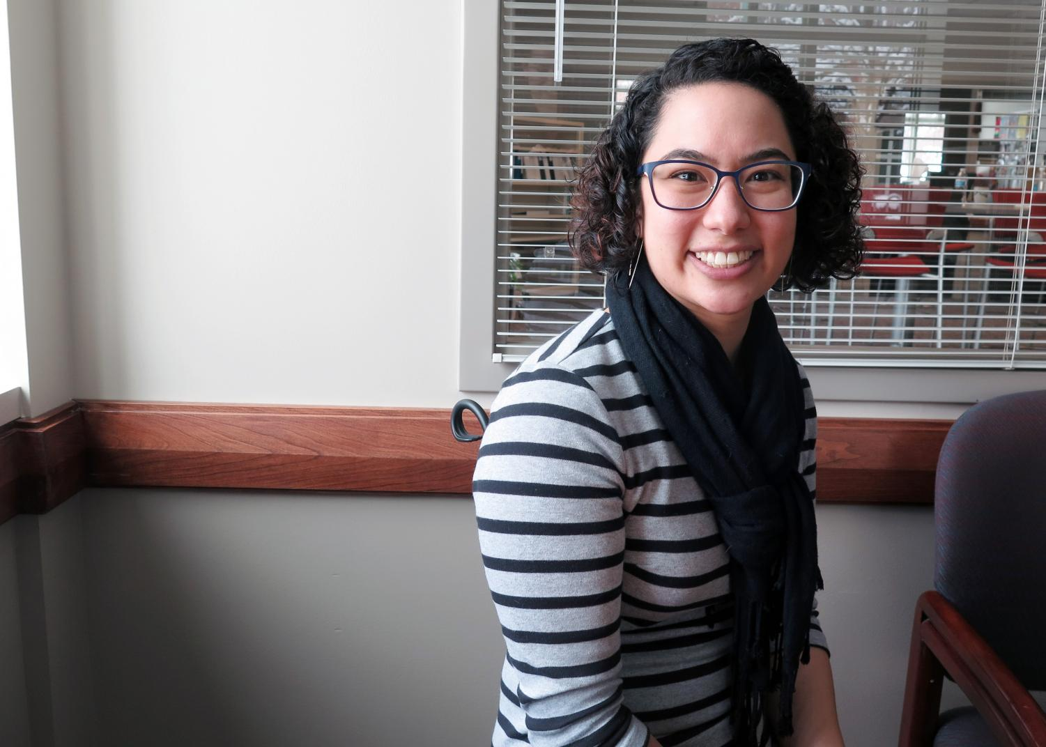 Abby Chien, of the Diversity and Equity Center, sits in her new office as she takes action in her position as Director.