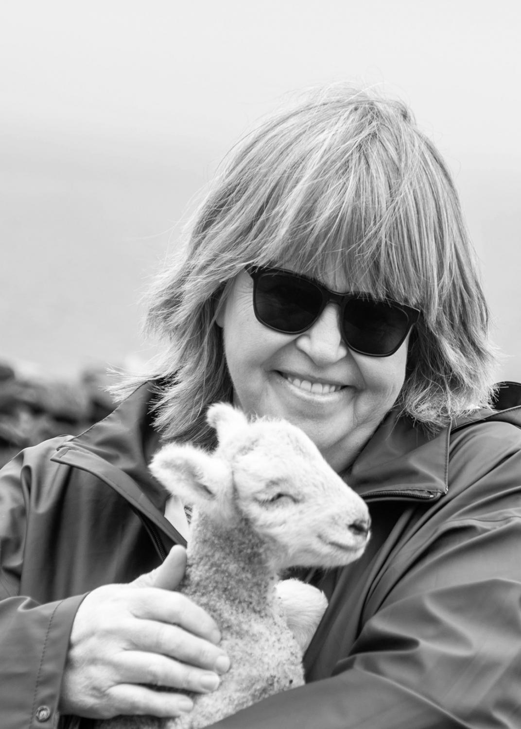 Jamie Gilbert holding a lamb in Dublin during her study abroad trip summer of 2018.