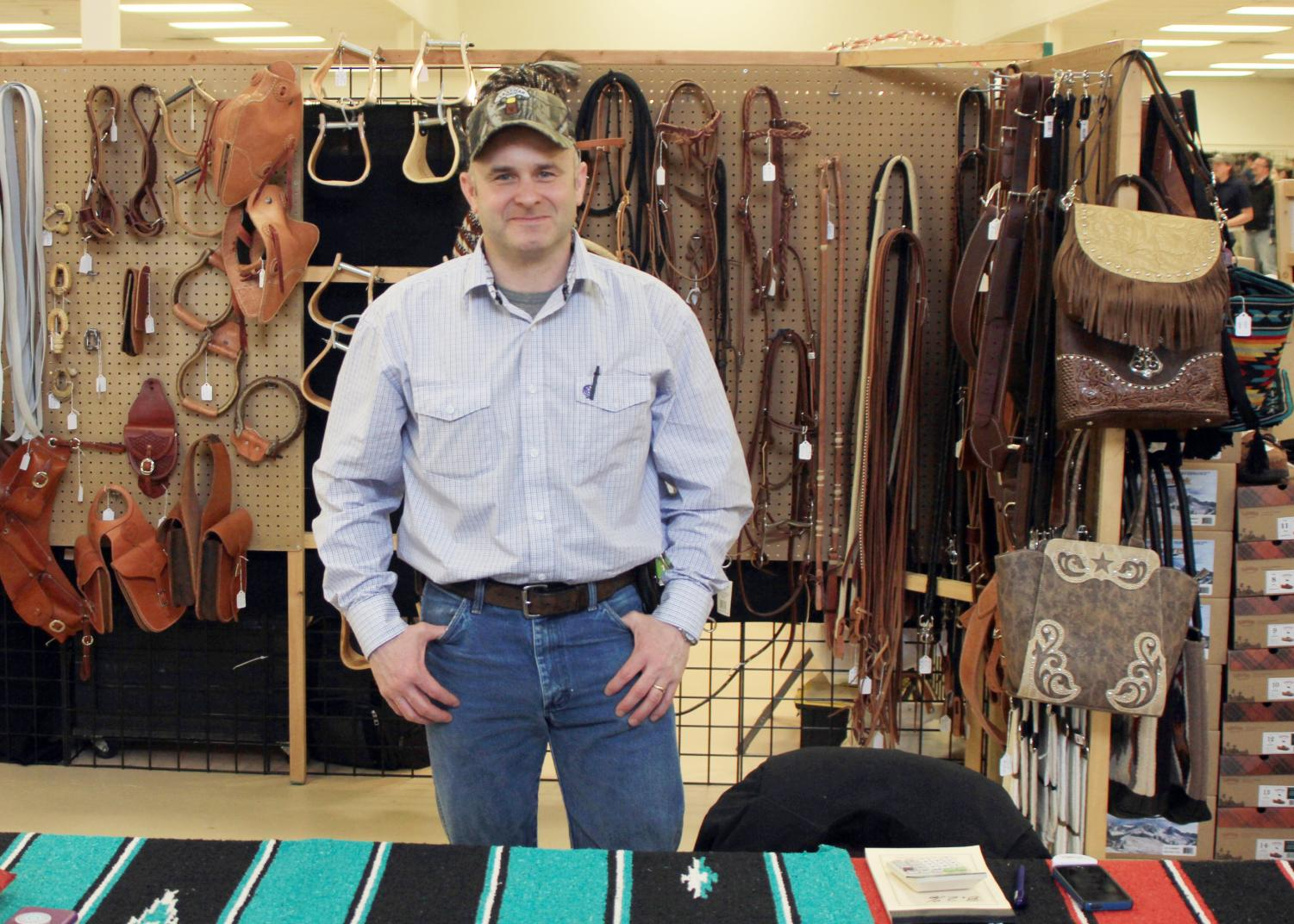 Don Bacon's Leather Shop owner stands in front of his booth last year at the Spirit of the West festival. Bacon's Leather Shop is a local shop that makes custom leather work.