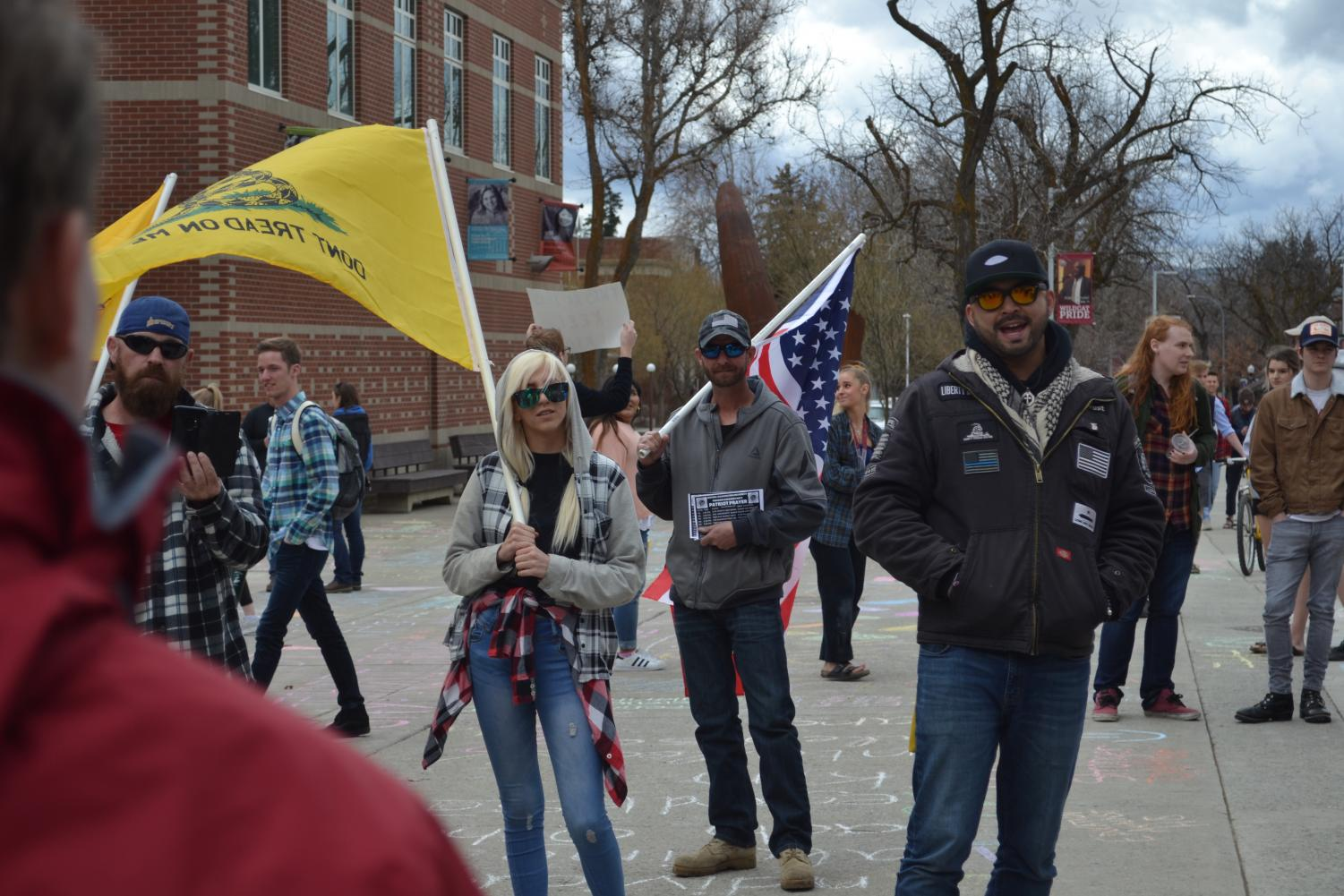 Patriot Prayer members debate with CWU students outside of Black Hall. Joey Gibson, founder of Patriot Prayer, can be seen in the black jacket and red sunglasses.