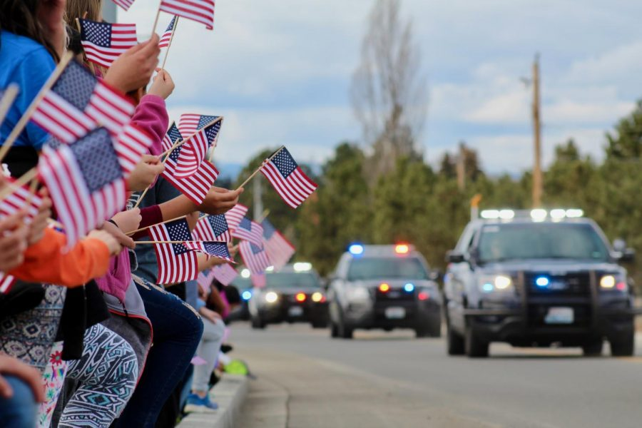 Students+from+Valley+View+Elementary+stood+silently+on+the+sidewalks+as+the+procession+for+Deputy+Ryan%0AThompson+passed+by.+Many+students+held+American+flags.