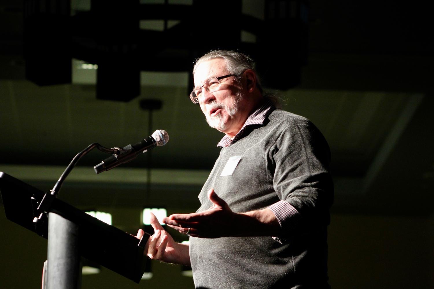 George Bellah, Associate Professor of theatre, presents a Distinguished Alumni Award at the CWU Alumni Banquet in the SURC Ballroom. The banquet included alumni as far back as 1968.