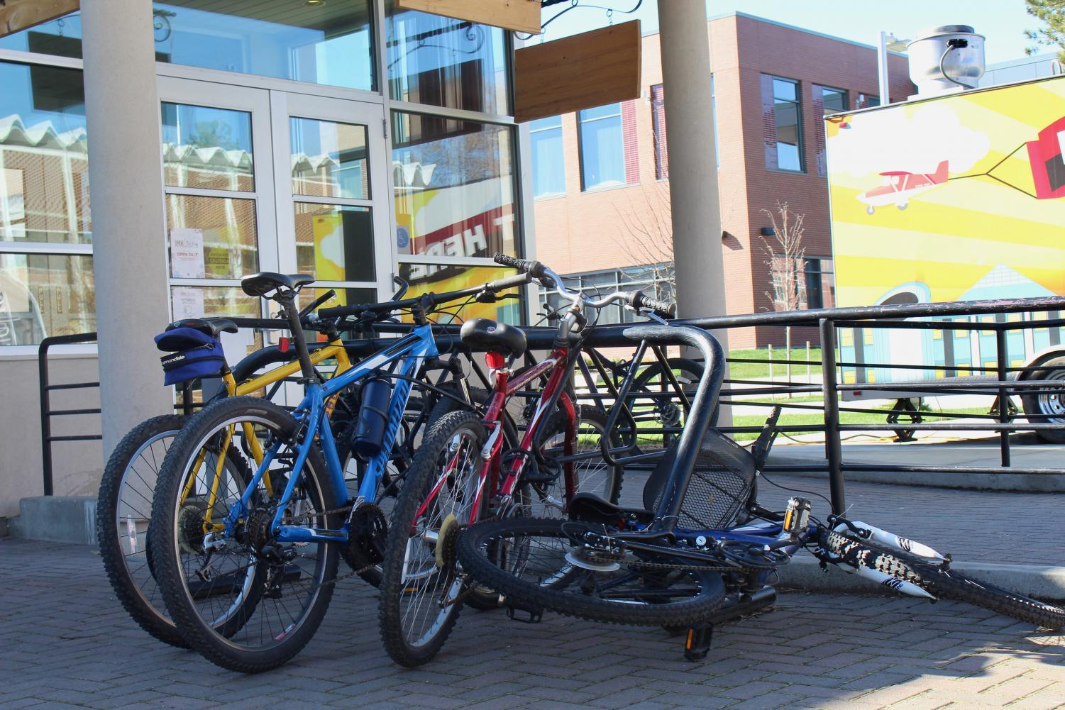 Bike racks can be found full around campus. Pictured above are multiple bikes outside of the 1891 Bistro. Students can register their bikes with CWU police to help track them down if they are ever stolen.