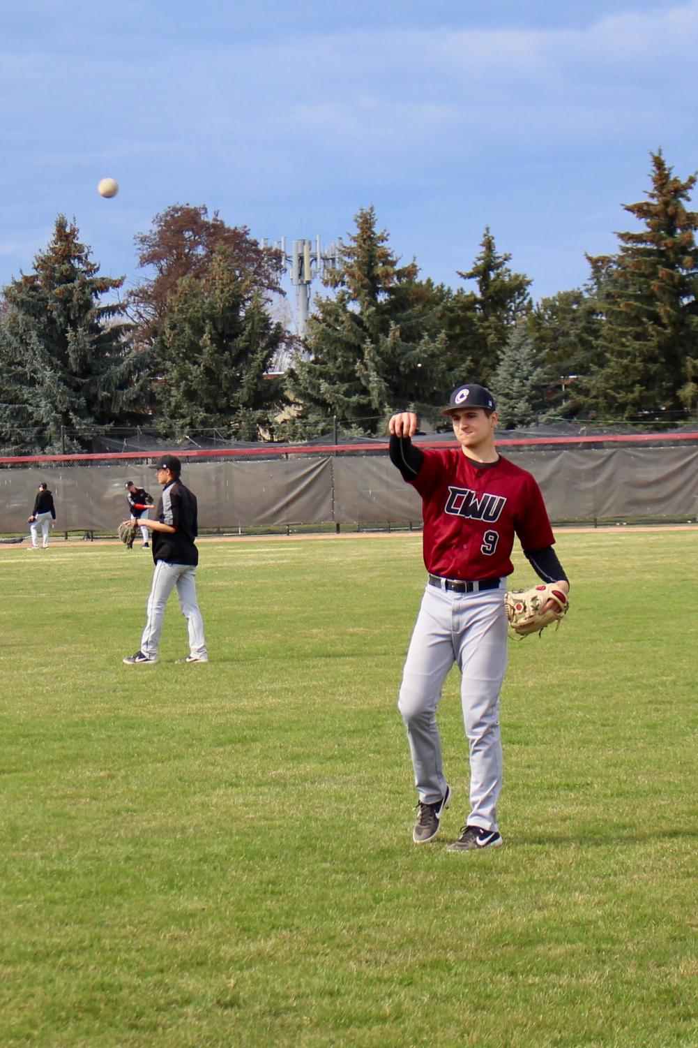 Sophomore Infielder Mitch Lesmeister warms up during practice. Soft toss gets the players arms stretched out.