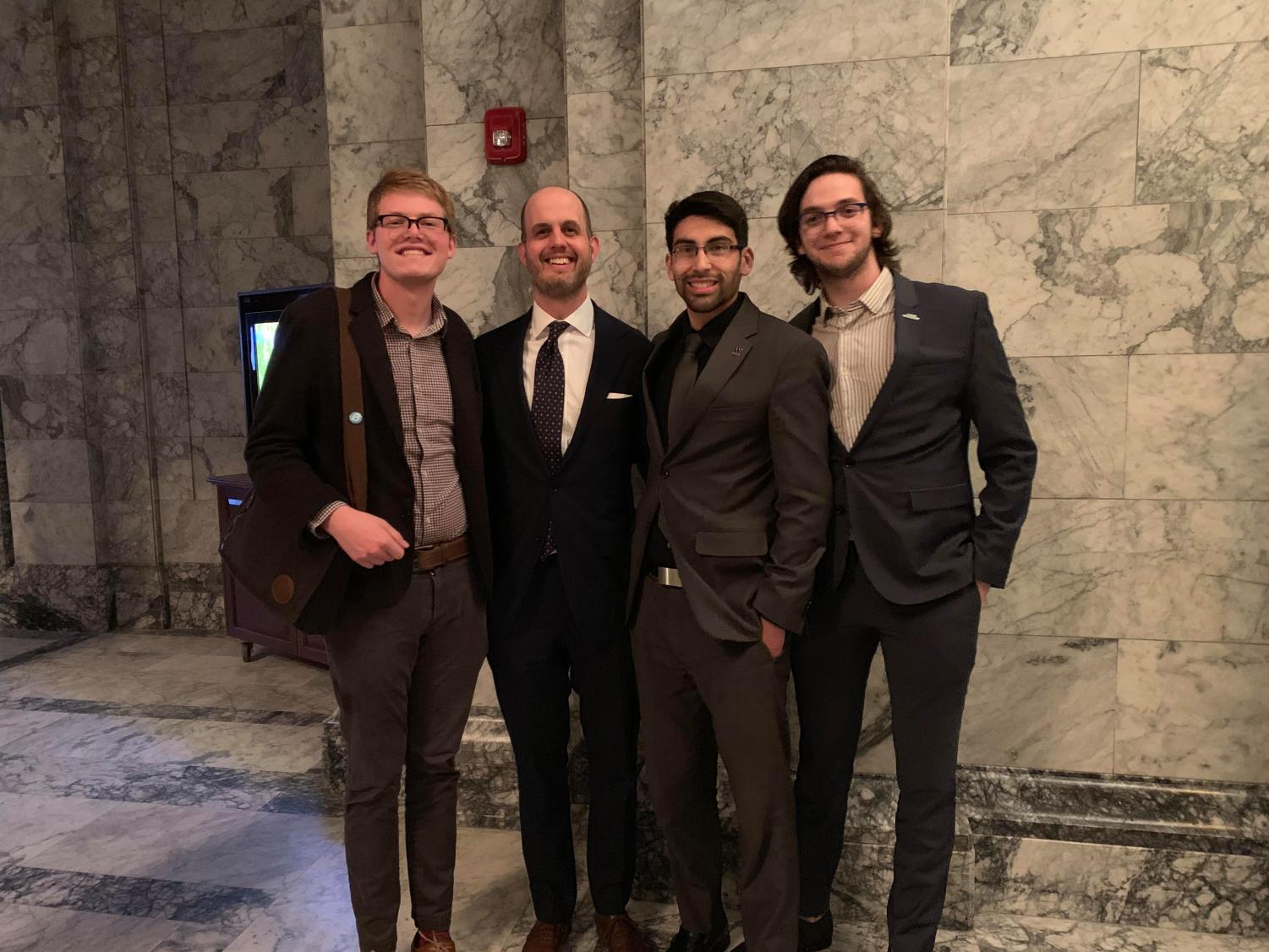 Representative Drew Hansen (center left) who wrote HB 2158, with some of the student legislative liaisons who helped him get the bill passed (left to right) Zack Turner (CWU), Adan Espino (University of Wash- ington), Henry Pollet (Webster Washington University).