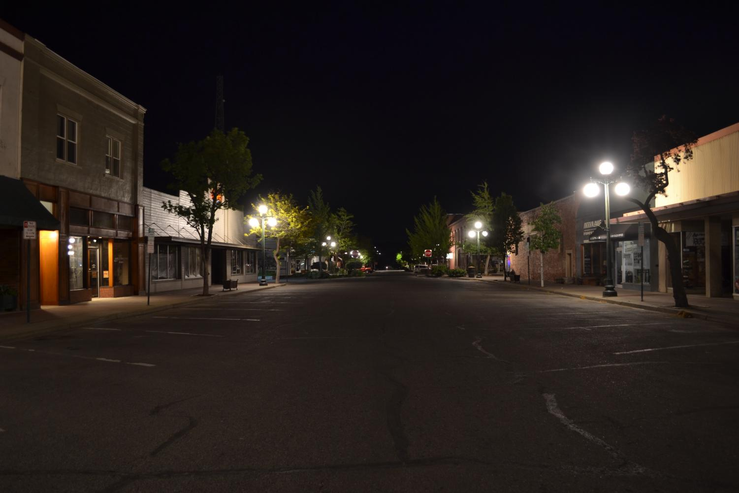 The streets of Ellensburg are empty with few vehicles passing through. Empty streets like this one show the lack of nighttime entertainment options for students who are under the age of 21.