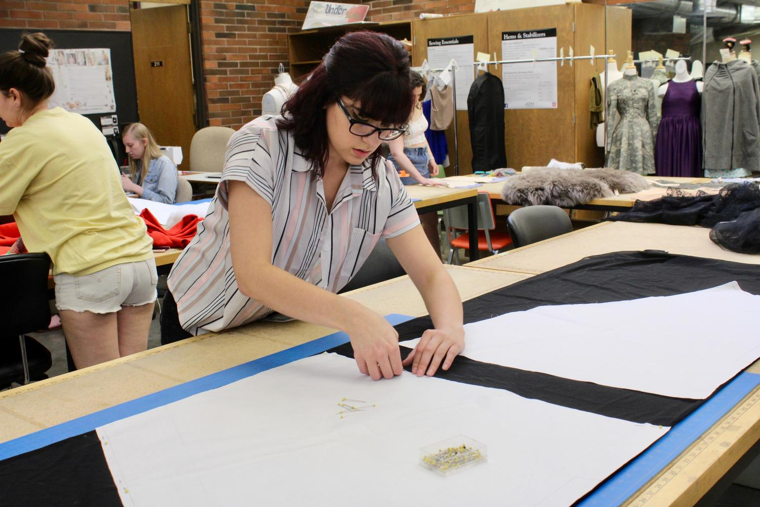 Oren Hilligso works on her garments for the upcoming 23rd Annual Fashion Show. Students will be presenting their original designs at show, which will take place June 1 at 3 p.m. and 7 p.m. at the Milo Smith Tower Theatre.