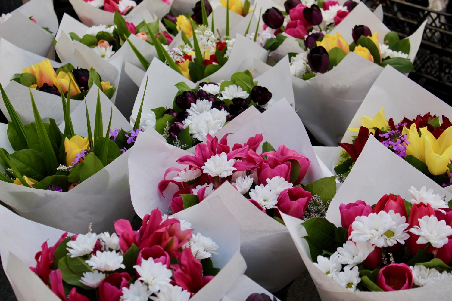 Vang Garden sold large and medium sized floral arrangements at the farmers market. Many people bought flower bouquets for their moth- ers and grandmothers for Mother's Day on May 12th.