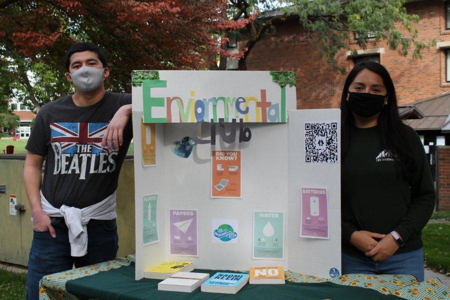 Christian Castilleja, treasurer (left) and Heidi Flores-Montiel, president (right) of the Environmental Club tabling at the club fair.