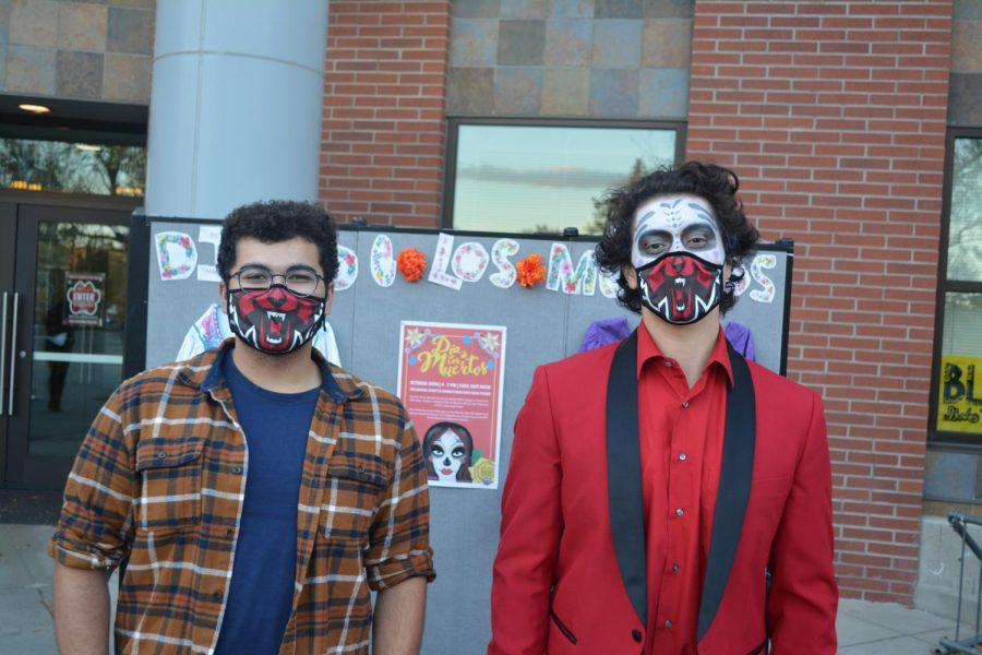Joey Packer (left) and Roberto Chavez (right). Diversity and Equity Center (DEC) staff provided games, pan de muerto and candy for students celebrating Día de los Muertos, or Day of the Dead.