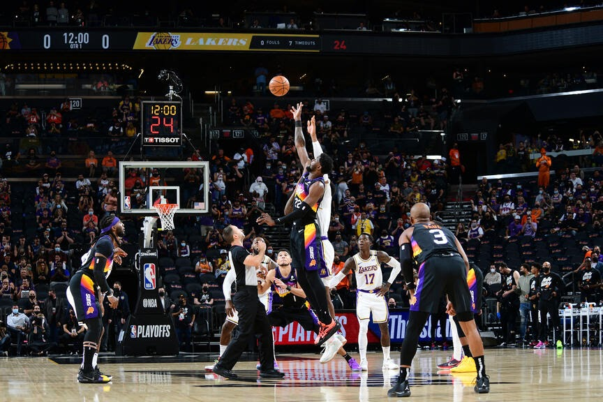 PHOENIX, AZ - MAY 23: Deandre Ayton #22 of the Phoenix Suns jumps for the tip against the Los Angeles Lakers during Round 1, Game 1 of the 2021 NBA Playoffs on May 23, 2021 at Phoenix Suns Arena in Phoenix, Arizona. NOTE TO USER: User expressly acknowledges and agrees that, by downloading and or using this photograph, user is consenting to the terms and conditions of the Getty Images License Agreement. Mandatory Copyright Notice: Copyright 2021 NBAE (Photo by Michael Gonzales/NBAE via Getty Images)