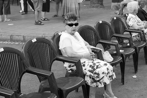 Old woman waiting for the parade at the Bonfires of Saint John